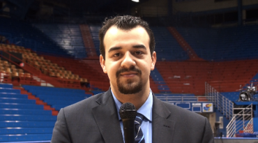 Doing a stand-up at Allen Fieldhouse after KU won its 10th straight Big 12 regular season title.