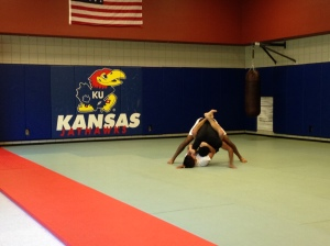 Cody Dean (bottom) trains with Abhi Shashikumar before practice at the KU Jiu-Jitsu club.