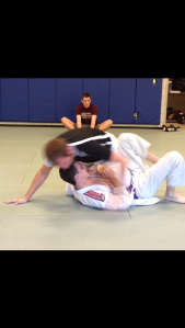 Christoph Goessing (bottom) tries to get off the ground and reverse positions with his opponent before practice at KU's Jiu-Jitsu club